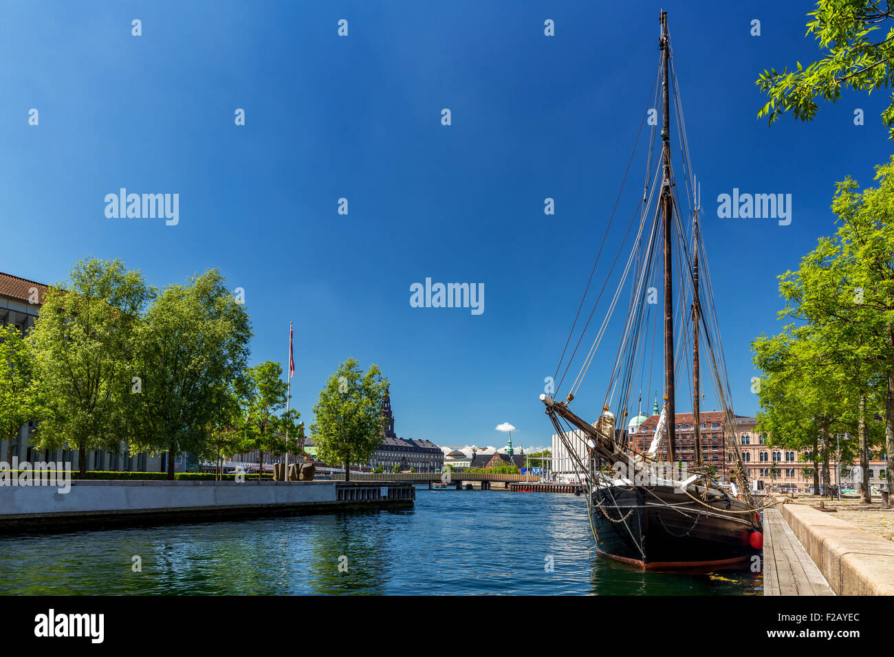 An old wooden ship near Eigtveds Pakhus, Conference center, Copenhagen, Denmark - Stock Image