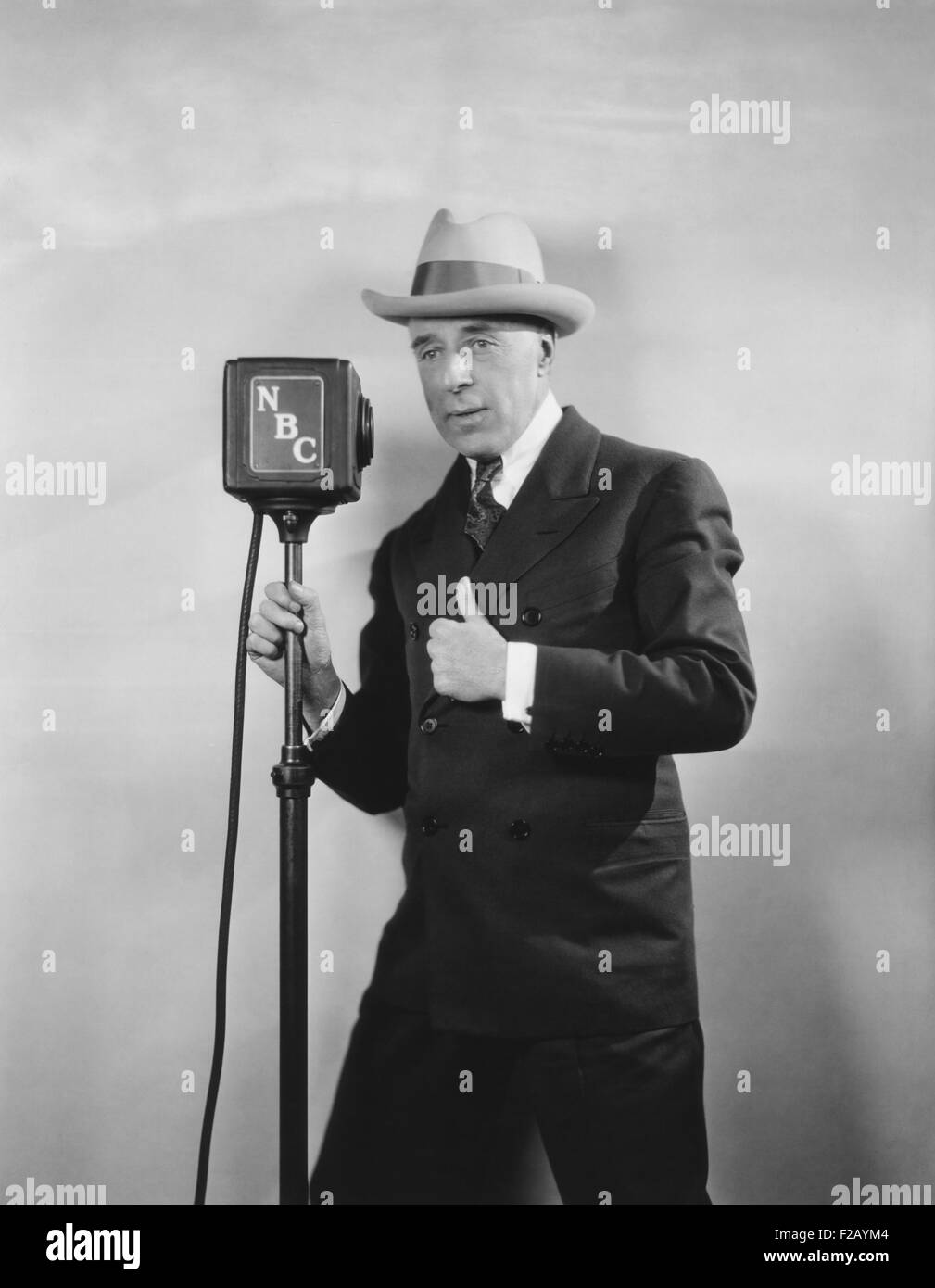 Legendary movie director D. W. Griffith broadcasting, 'D. W. Griffith's Hollywood.' Ca. 1930. The NBC - Stock Image