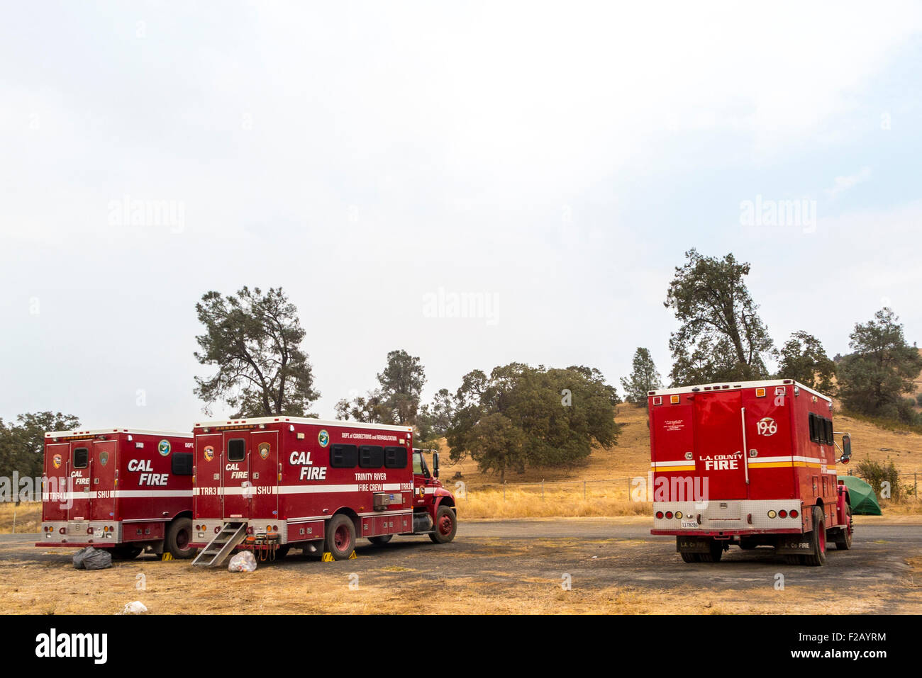 Three Calfire trucks at the Calaveras County Fairgrounds in Angels camp California there to fight the Butte Fire. - Stock Image