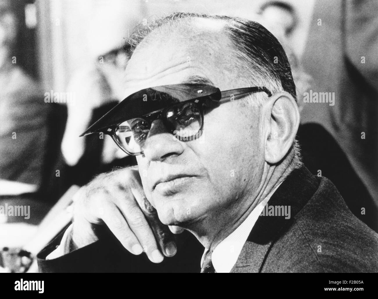 Sen. J. William Fulbright wears a sun visor to shield his eyes from the TV lights. Mar. 11, 1969. As Chairman of - Stock Image