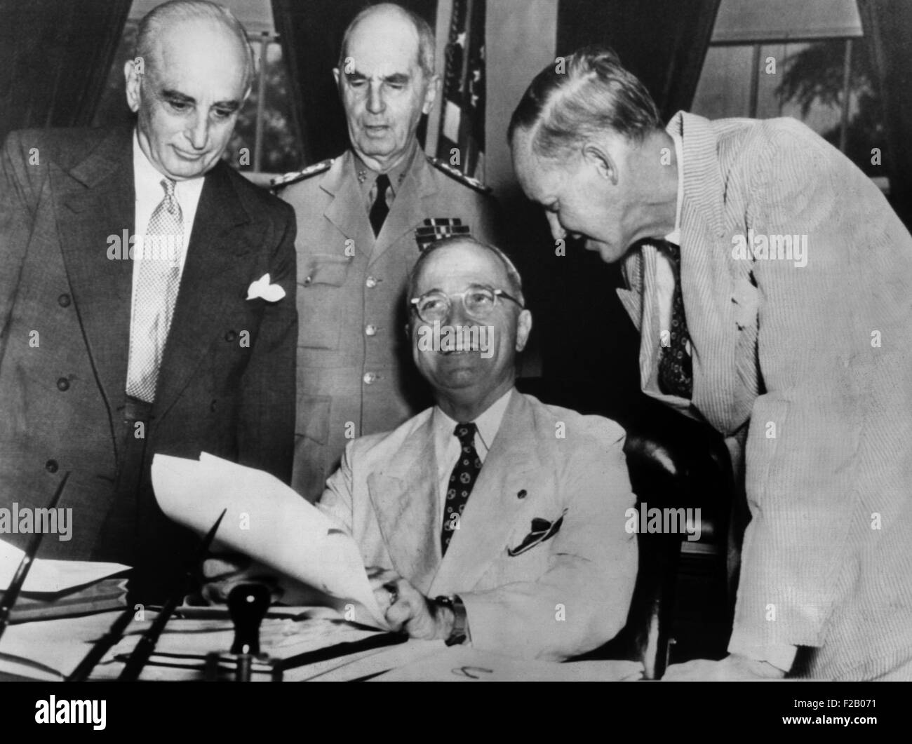President Harry Truman with advisors on June 13, 1945. At right, Harry Hopkins, who just returned from a 3-week - Stock Image