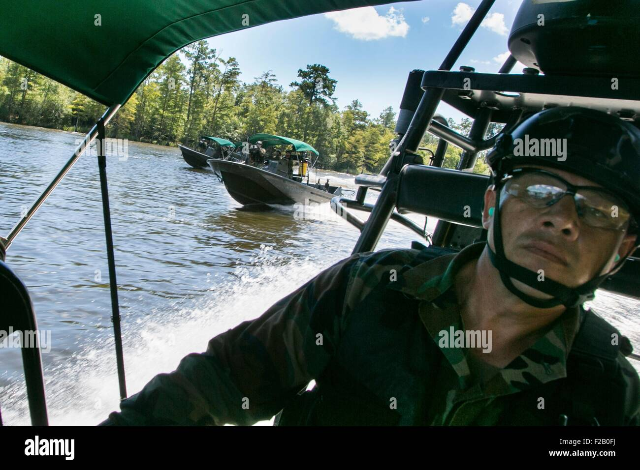 International special operation forces train as part of the Waterborne Instructor Course Riverine at Naval Small - Stock Image