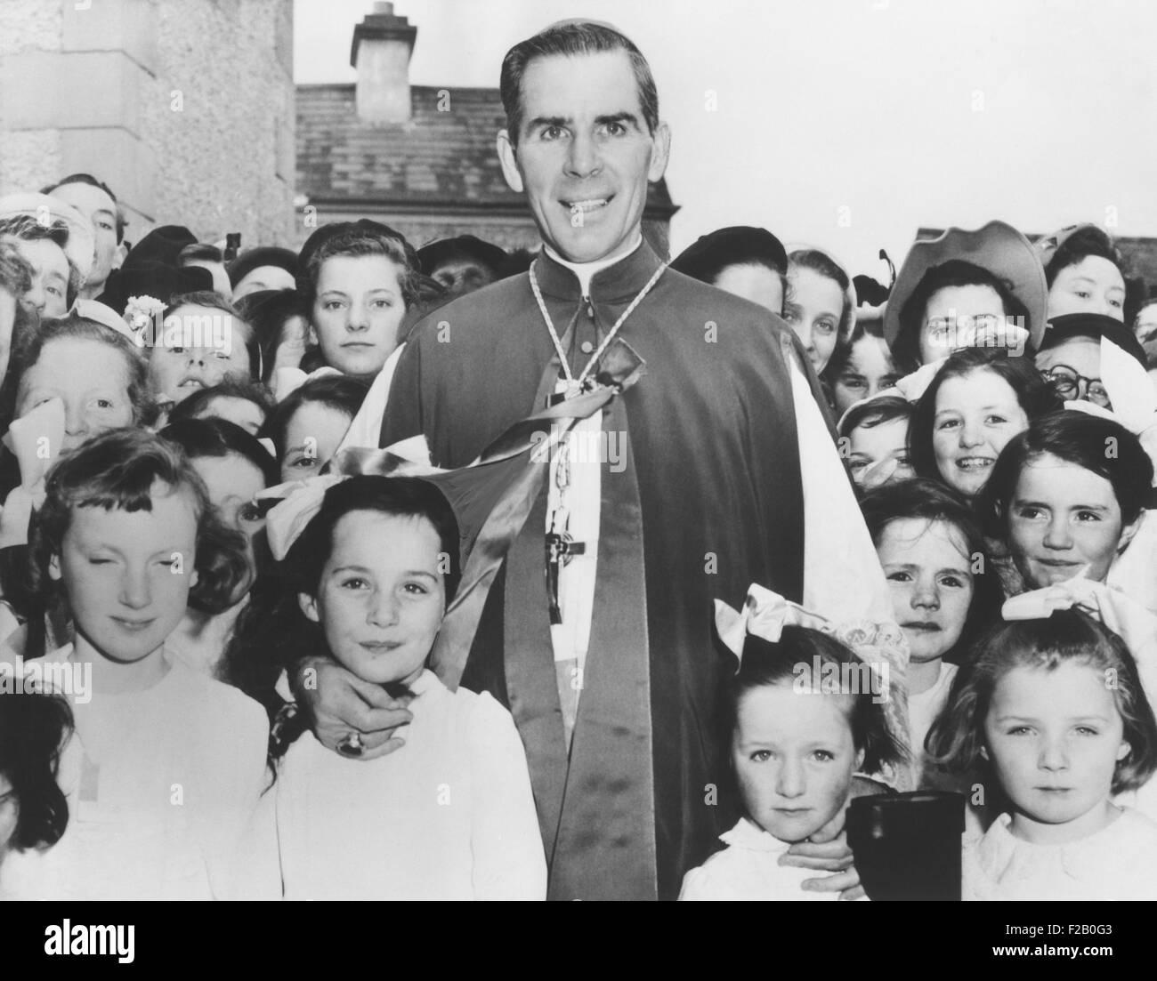 Bishop Fulton Sheen with Irish children in Choghan County, Roscommon, Ireland. April 22, 1952. Bishop Sheen's - Stock Image