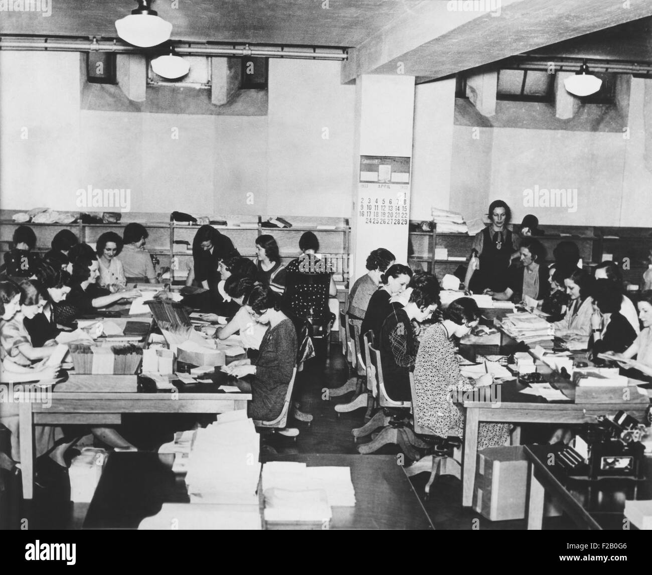 Charles Coughlin had a large staff to open and sort 80,000 letters he received weekly. April 1933. (CSU_2015_9_1141) - Stock Image