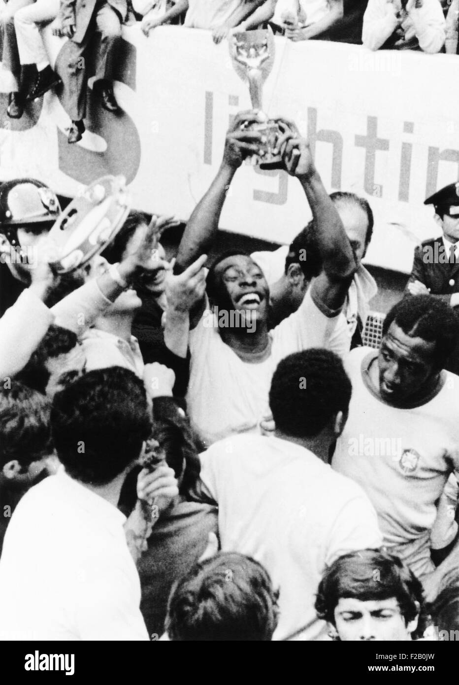 Pele in triumph in Mexico City, June 21, 1970. He holds up the Jules Rimet Cup, won by Brazil for defeating Italy - Stock Image