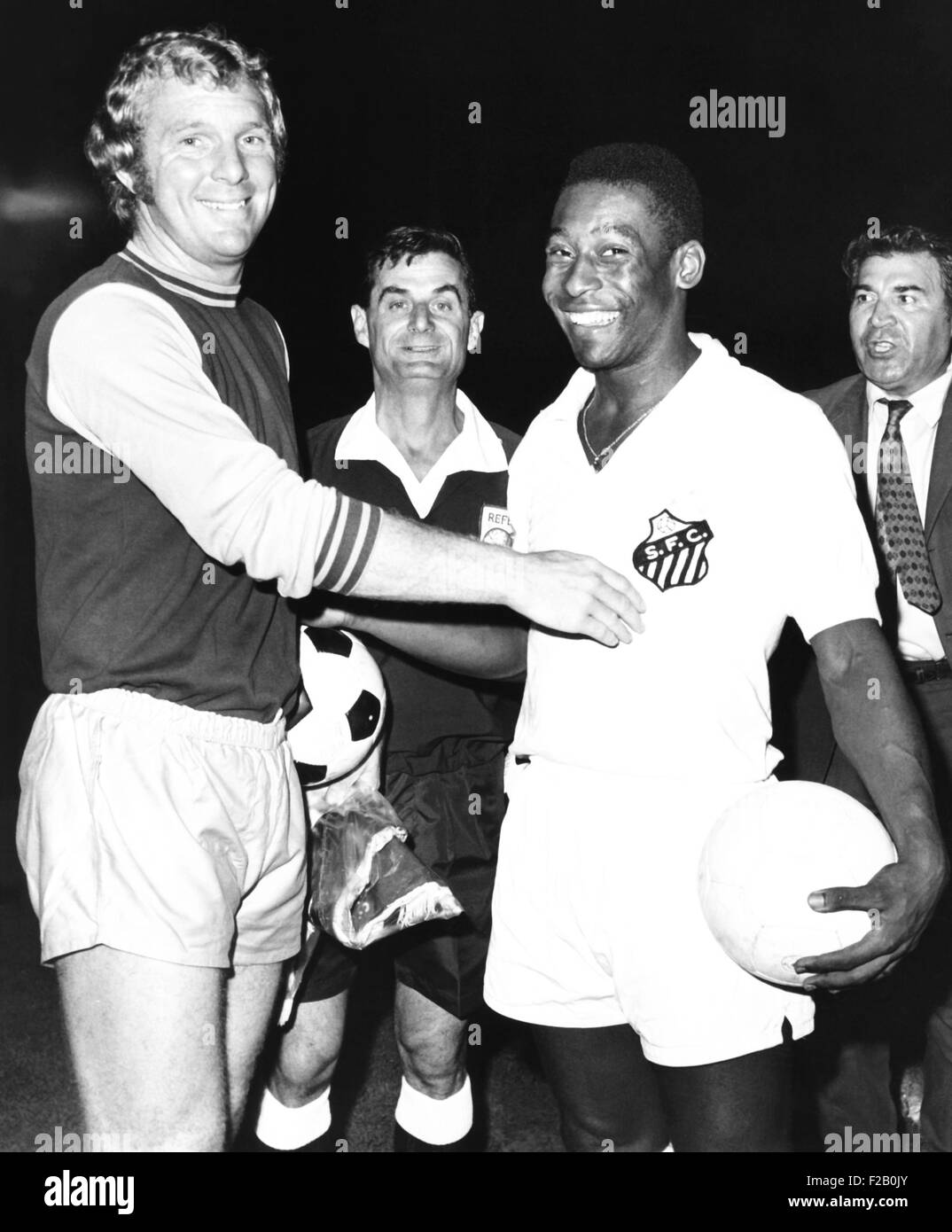 Pele of Santos of Brazil with Bobby Moore, the halfback of West Ham United, England. They were playing a soccer - Stock Image