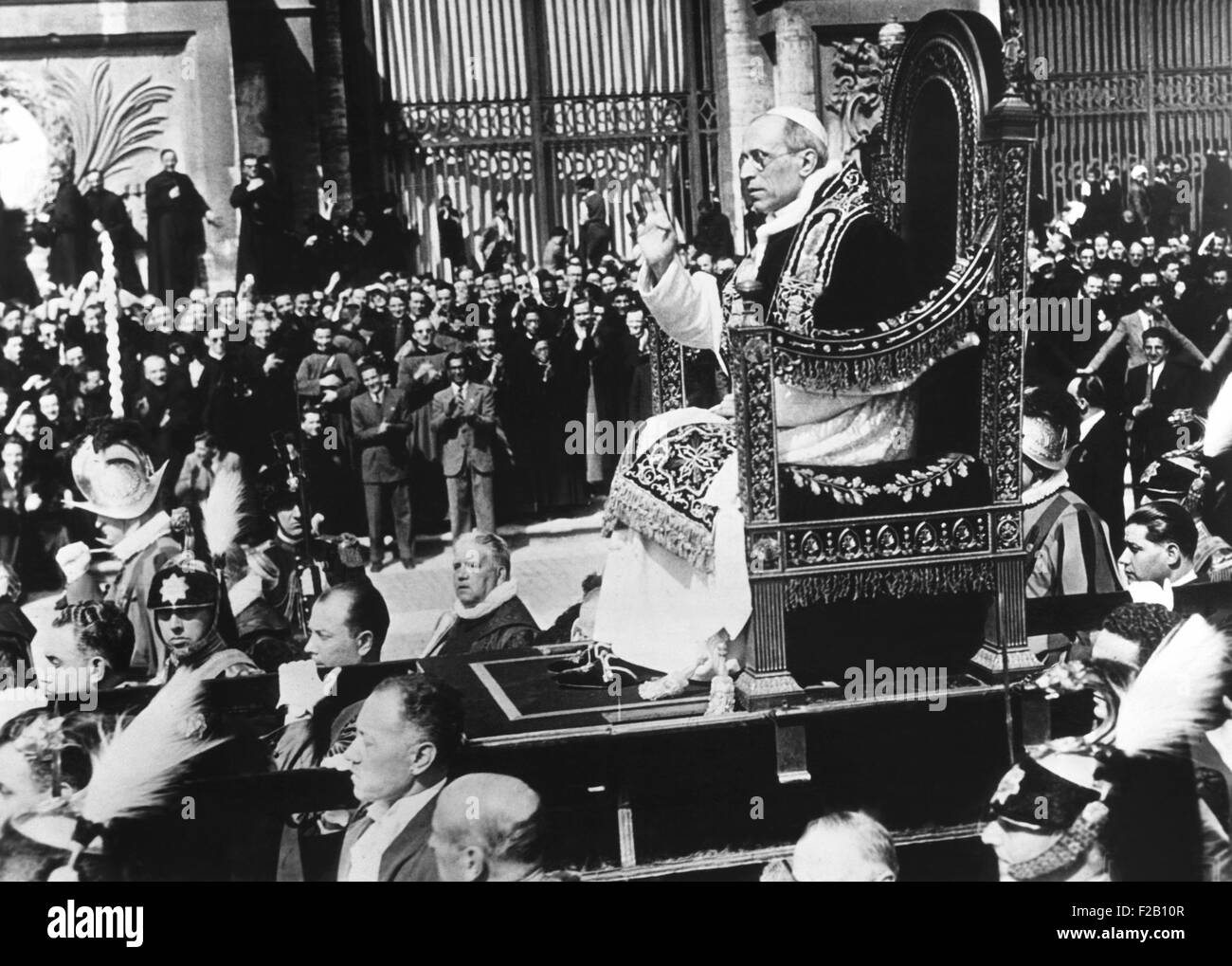 Pope Pius XII in procession to take formal possession of the Church of St. John Lateran in Rome. He is carried across - Stock Image