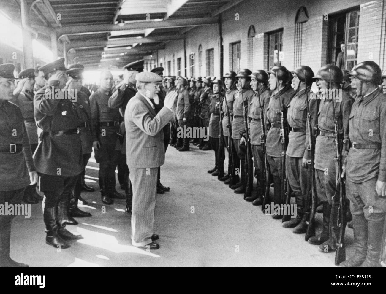 Mikhail Kalinin, Chairman of the Presidium of the Supreme Soviet, reviews troops at Vyborg. Three month after Finland's - Stock Image