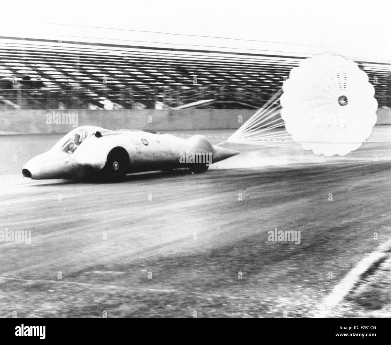 Art Arfons on the Thompson Raceway dragstrip opens twin parachutes to decelerate speed. 1962. (CSU_2015_7_425) - Stock Image