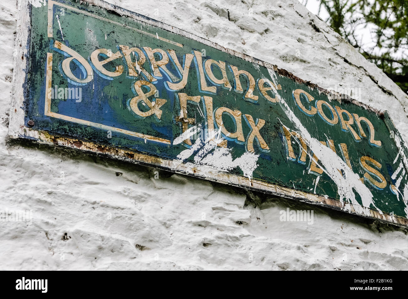 Old sign at Derrylane corn and flax mills - Stock Image