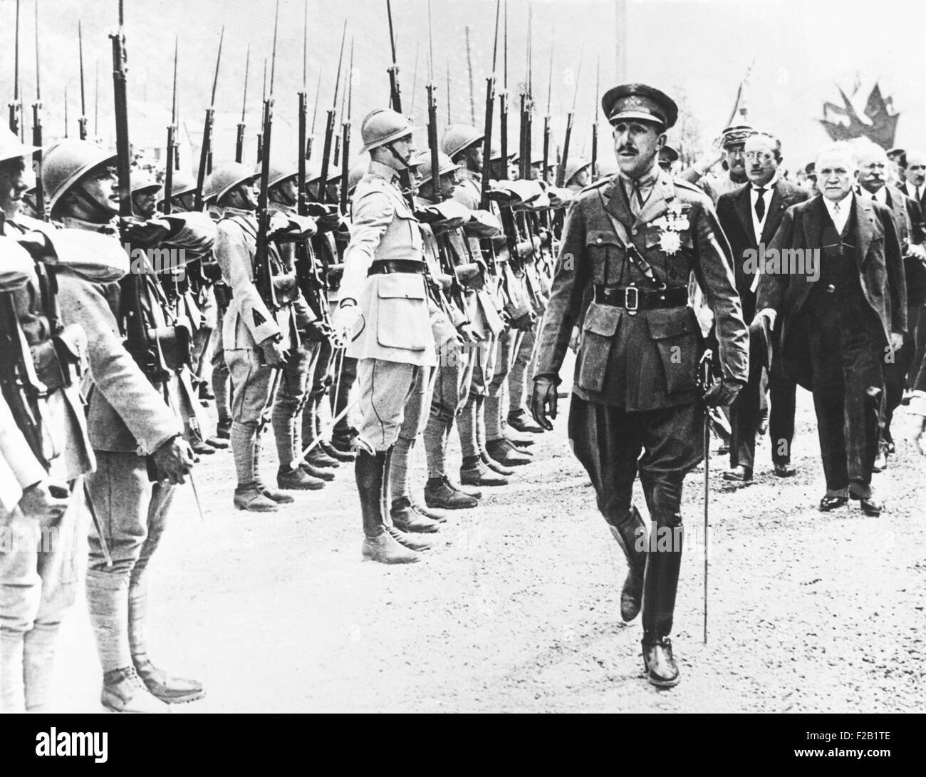 Alfonso VIII, King of Spain, reviewing French Troops, July 1928. Behind him at left is French Prime Minister Gaston - Stock Image