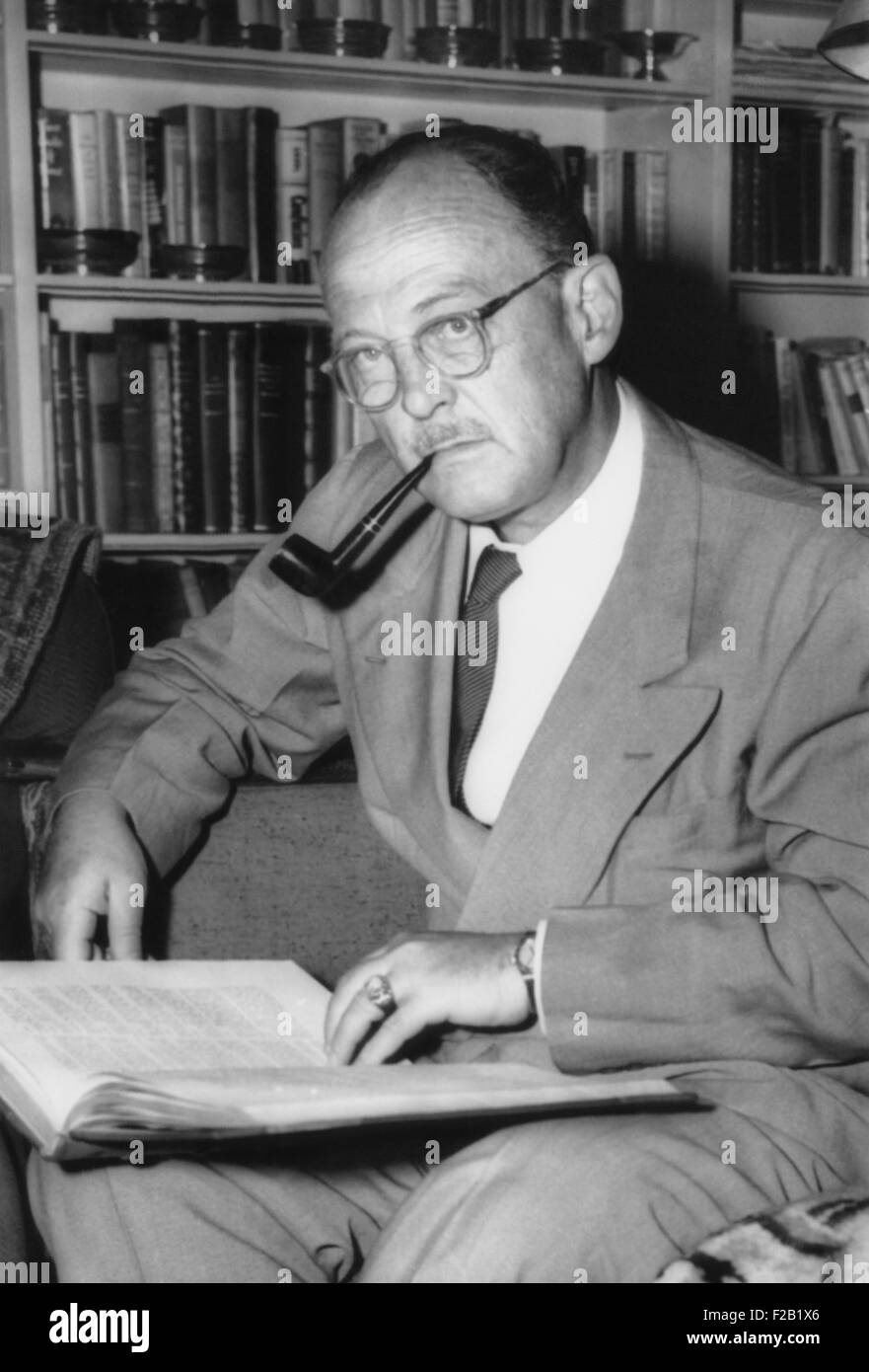 Owen Lattimore, Far Eastern scholar, in the library of his Baltimore home. July 9, 1954. He fought Joseph McCarthy's - Stock Image