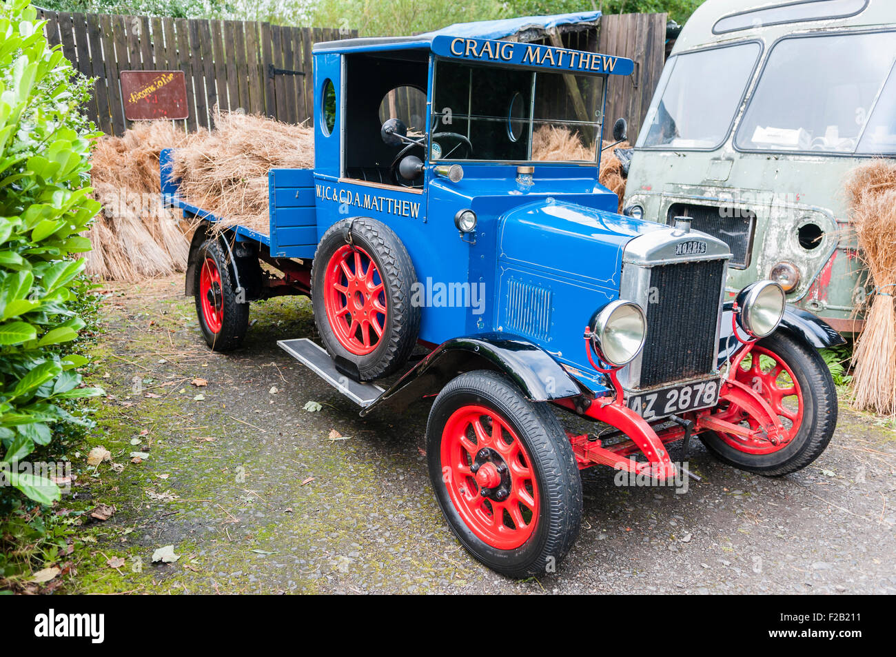 "Bundles of flax on the back of a vintage flatbed lorry with the name ""Craig Matthew"" Stock Photo"