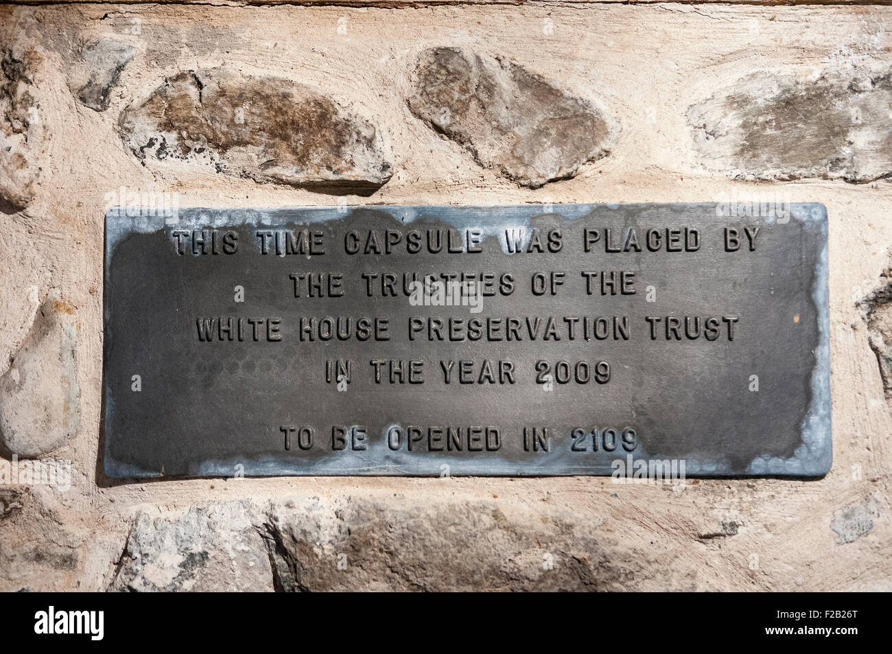 Cast iron plaque in the White House, County Antrim, advising that the time capsule behind should be opened in 2109. Stock Photo
