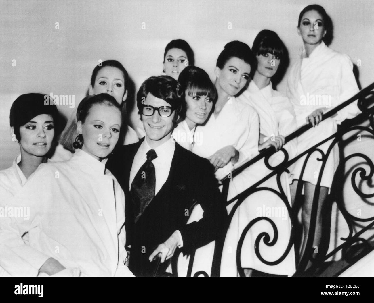 French fashion designer Yves Saint Laurent with models showing his 1967 spring summer collection. The models are - Stock Image
