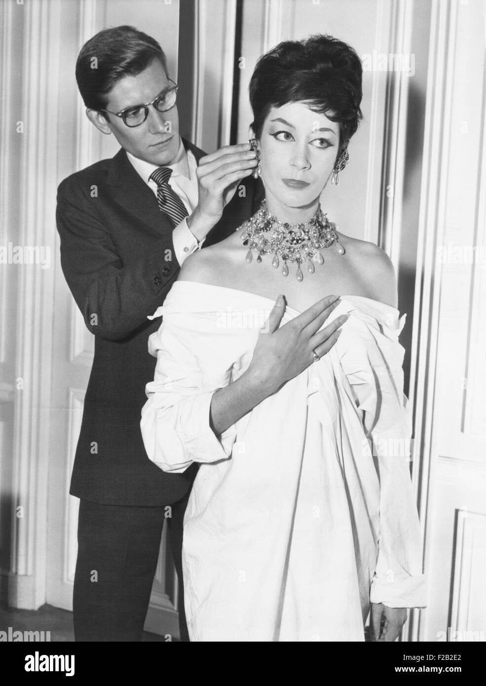 French fashion designer Yves Saint Laurent putting earing on model. Jan. 18, 1962. (CSU_2015_7_380) - Stock Image