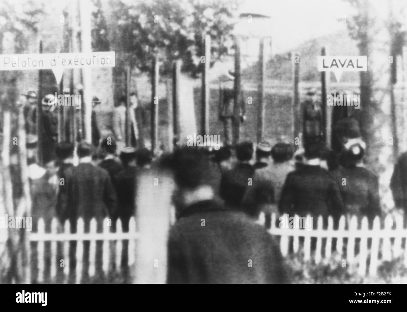 Execution of Pierre Laval on Oct. 17, 1945. The firing squad is at left, and Laval is at right, in the courtyard - Stock Image