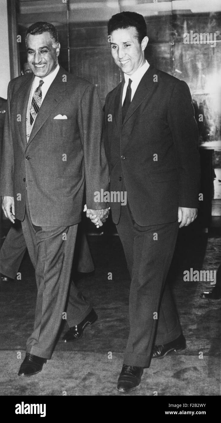 Gamal Abdel Nasser walks hand in hand with Algerian rebel leader Ahmed Ben Bella. April 17, 1962. Recently released - Stock Image