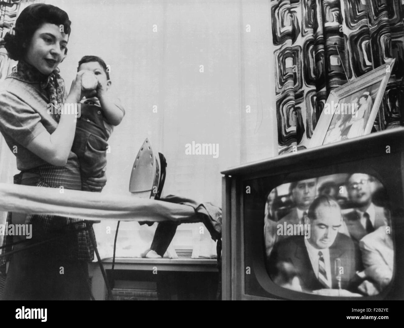 A New York City mother watches a televised Army McCarthy Hearing. In April 1954, the American public got a full - Stock Image