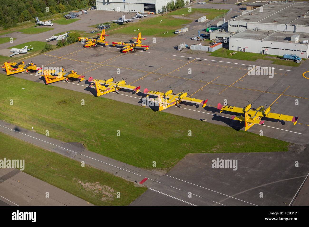 CL215, CL215T and CL415 water bombers are parked at the SOPFEU base at the Quebec city Jean Lesage airport in Quebec - Stock Image