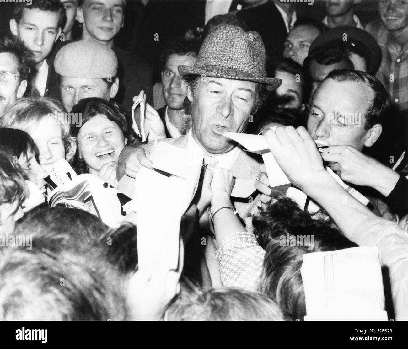 British Actor Rex Harrison stepped into a swarm of Russian autograph seekers outside his hotel. Harrison was in - Stock Image