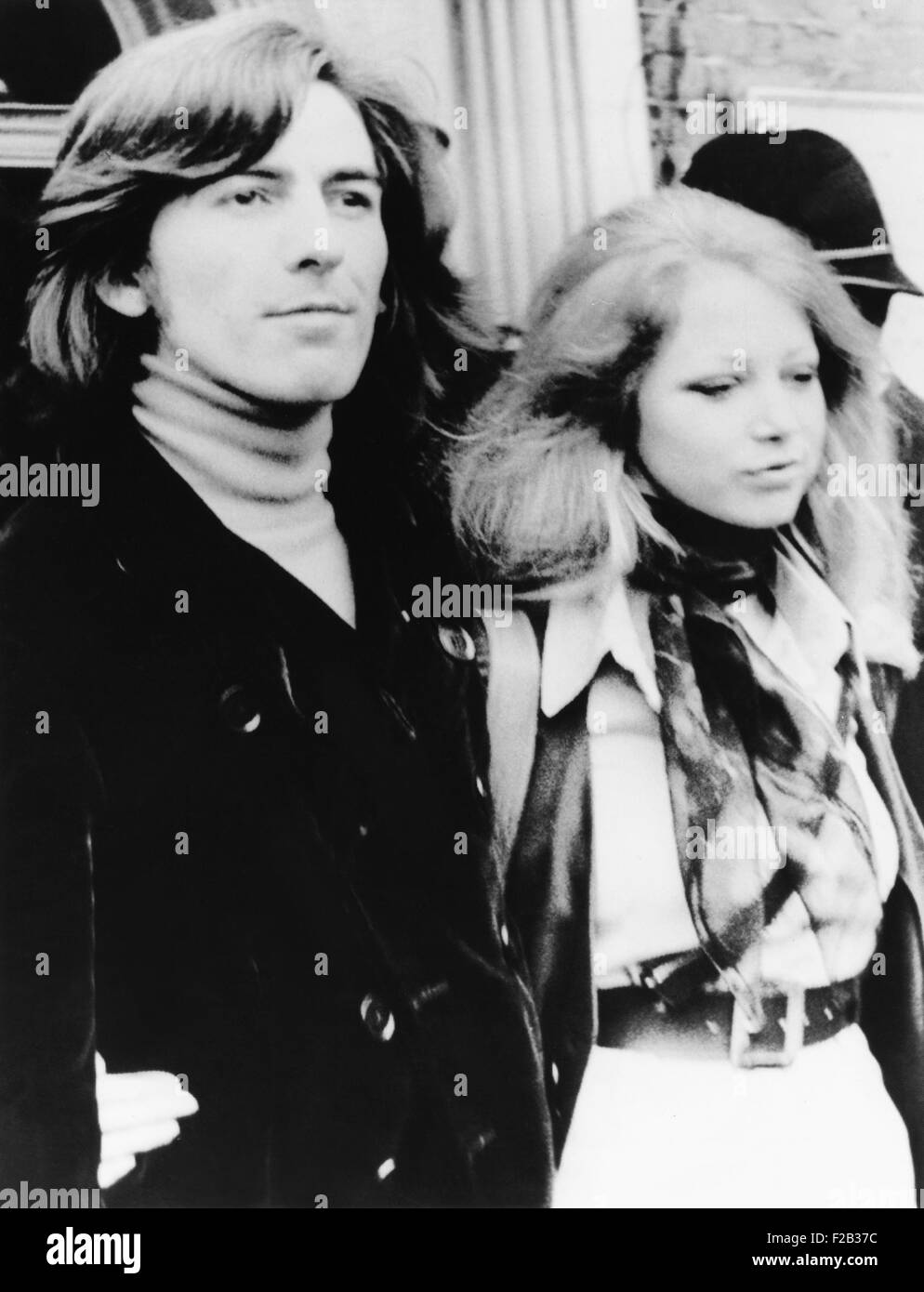 George Harrison and wife Pattie Boyd leave Walton and Esher Magistrates Court on March 18, 1969. They appeared on - Stock Image