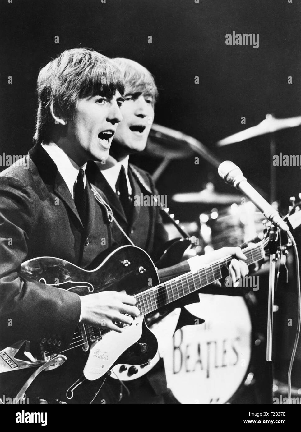 George Harrison (left) and John Lennon of the Beatles. Ca. 1964. (CSU 2015 7 276) Stock Photo