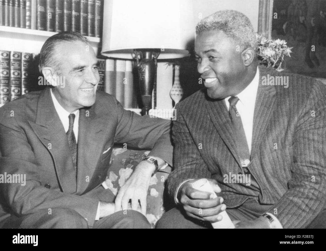 New York's governor Averill Harriman meets with Jackie Robinson. The first African American player in major league - Stock Image