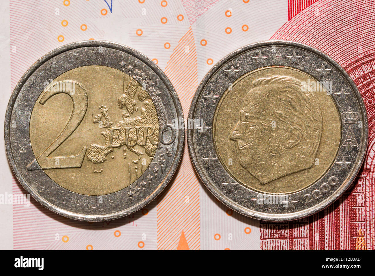 Heads or tails you decide, on euro bank paper - Stock Image