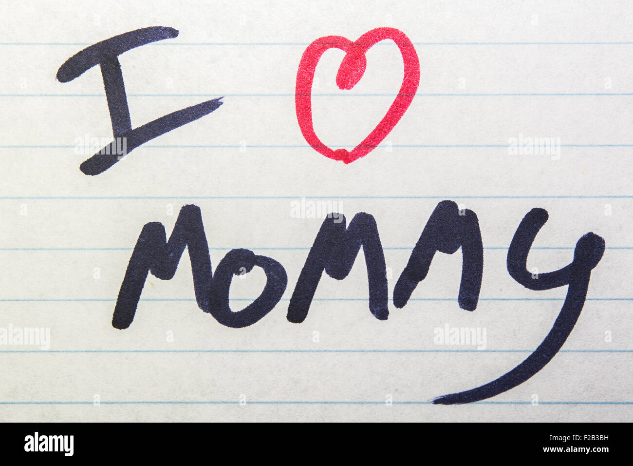 I Love Mommy written on piece of paper - Stock Image