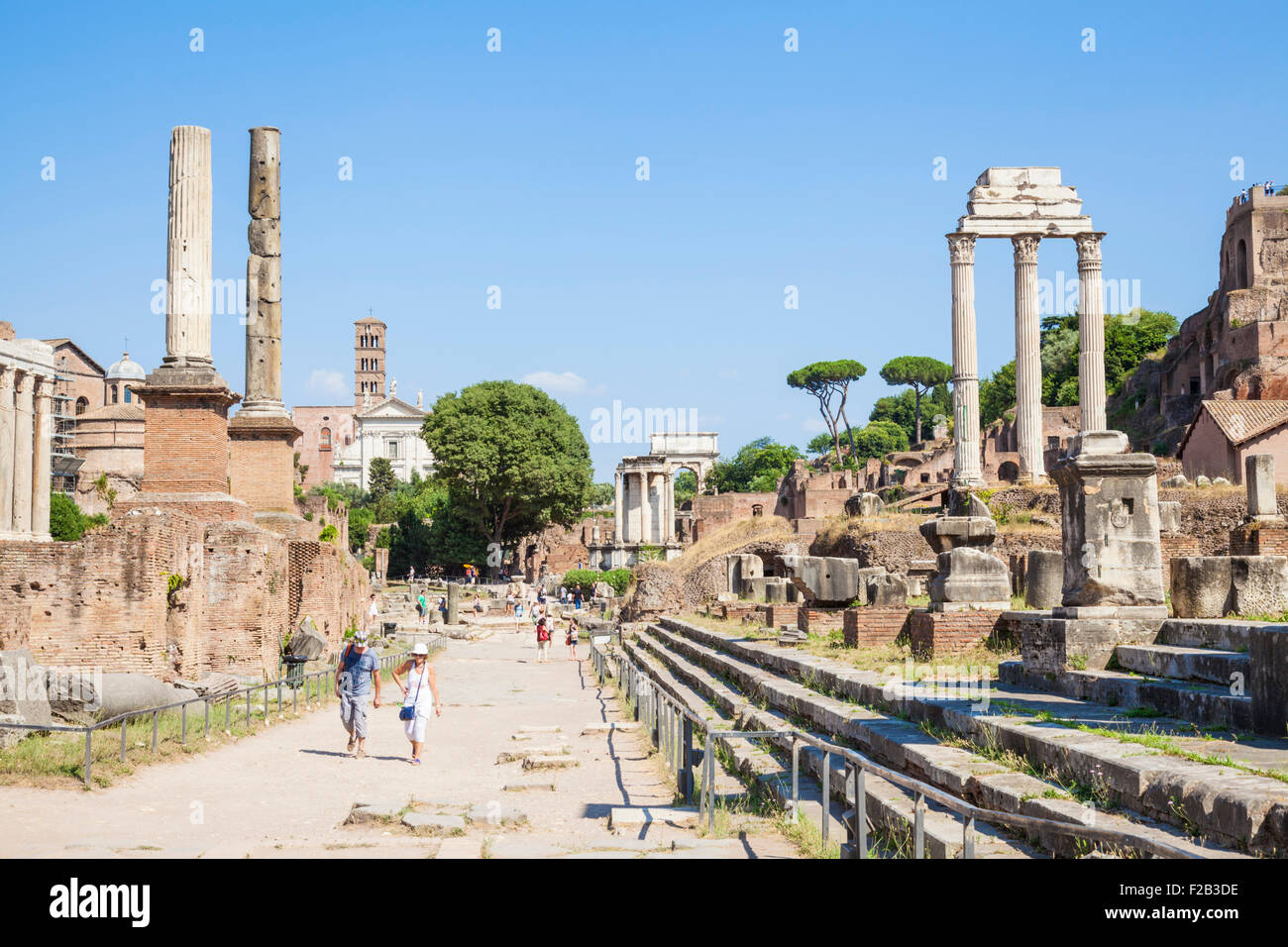 Looking up the Roman Forum from the Via Sacra towards the Temple of Castor and Pollux  Rome Italy Roma Lazio  Italy - Stock Image