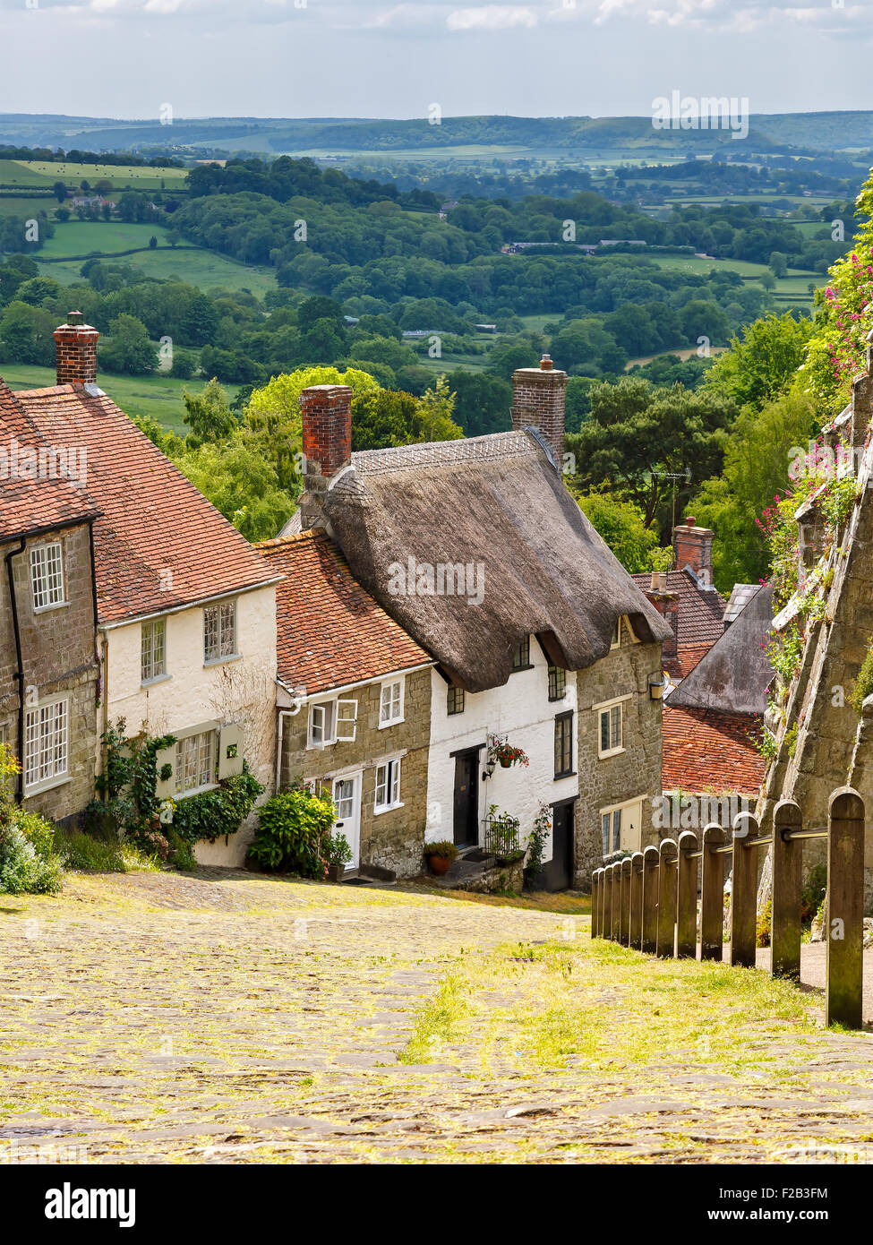 Famous view of Picturesque cottages on cobbled street at Gold Hill, Shaftesbury Dorset England UK Europe Stock Photo