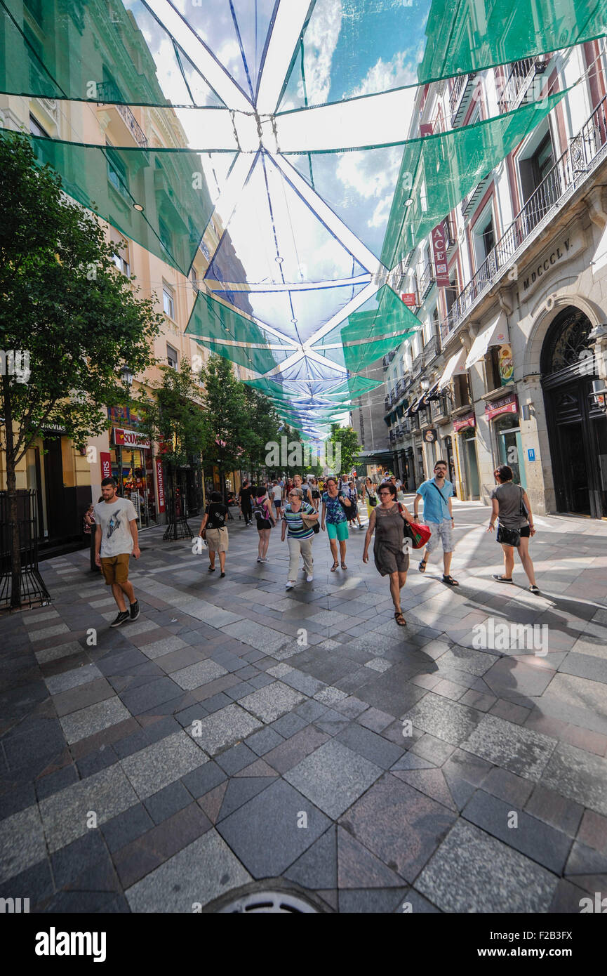 street covered by awning-calle cubierta por toldo - Stock Image