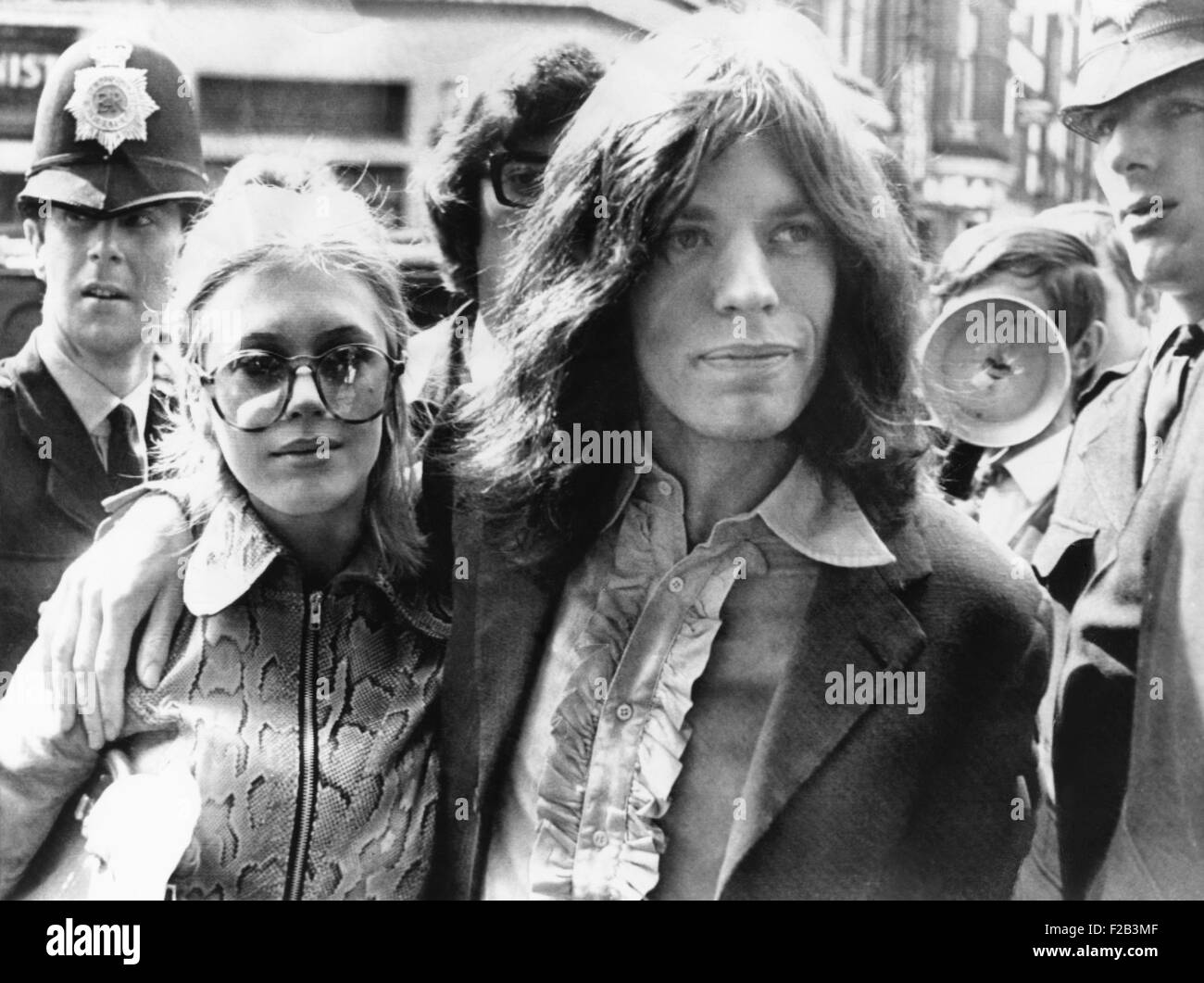 Mick Jagger and his girl friend, singer Marianne Faithful arrive at Magistrate's Court. The couple faced charges - Stock Image