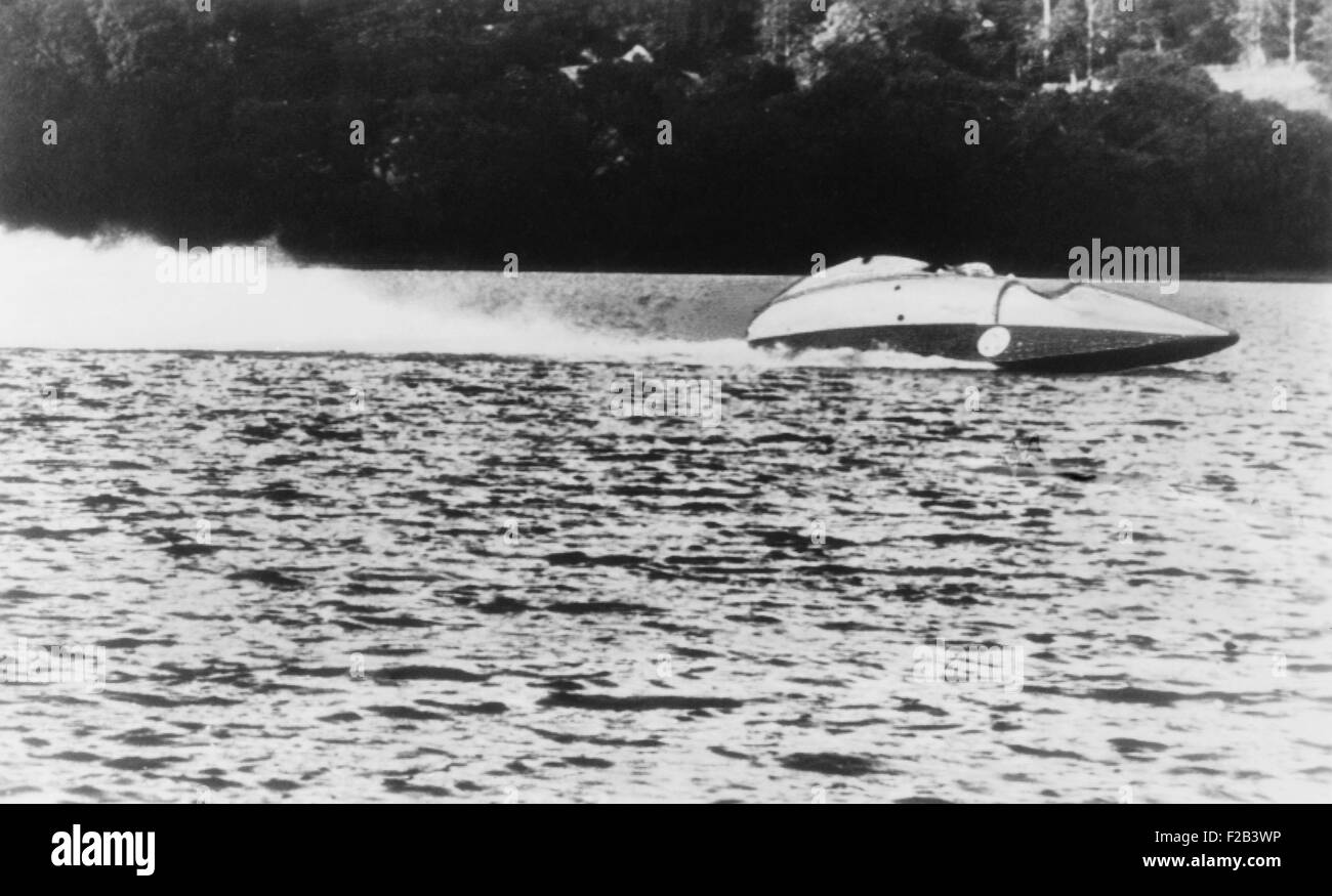 Sir Malcolm Campbell speeds over Lake Coniston in Bluebird II it a trial run in June 1947. He was preparing to beat - Stock Image