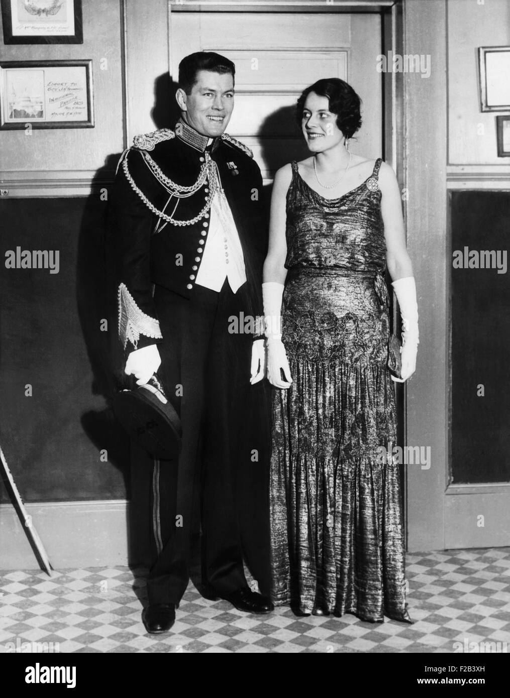 Gene Tunney and wife Polly Lauder Tunney in formal attire. He is wearing a dress uniform of the Marine Corps. Tunney - Stock Image