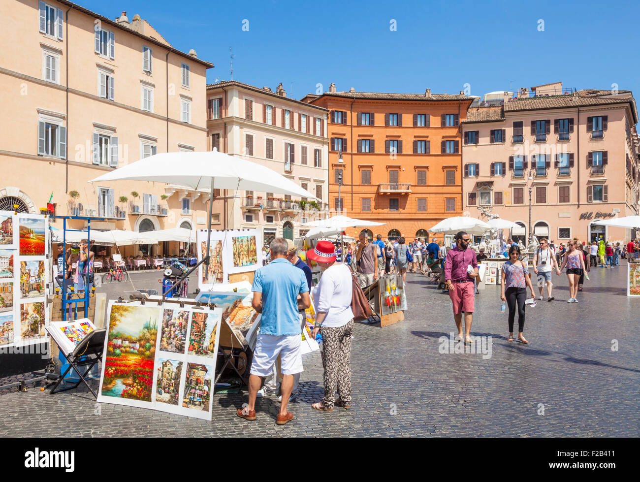 Artists painting and selling artwork in the Piazza Navona Rome italy Roma lazio italy eu europe - Stock Image