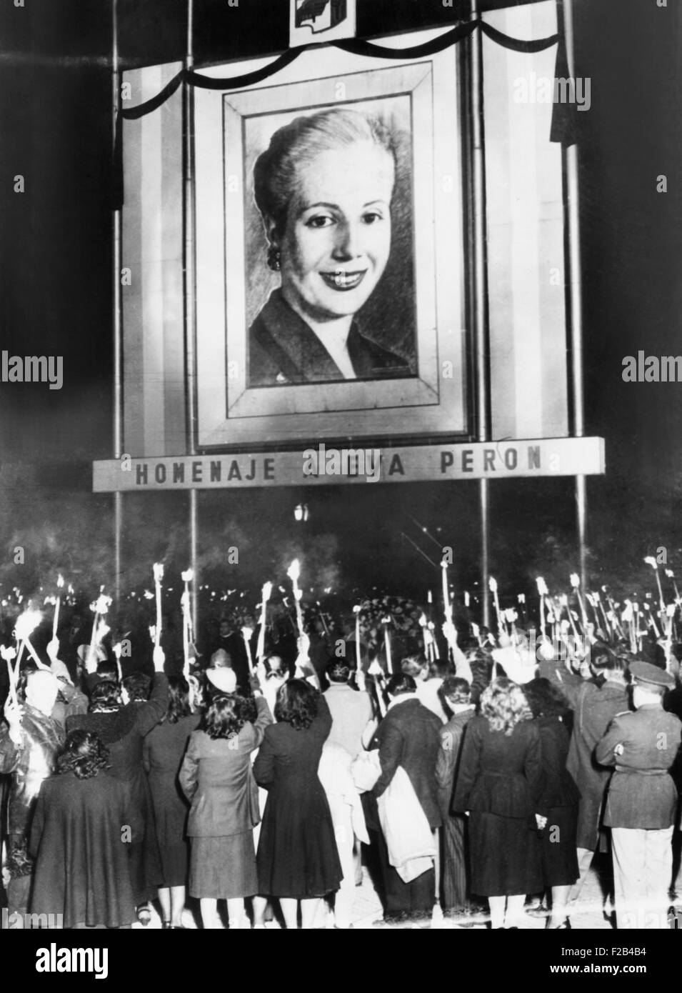 Honor Eva Peron. Argentines mourning the death of Eva Peron beneath a huge portrait of the deceased wife of their - Stock Image