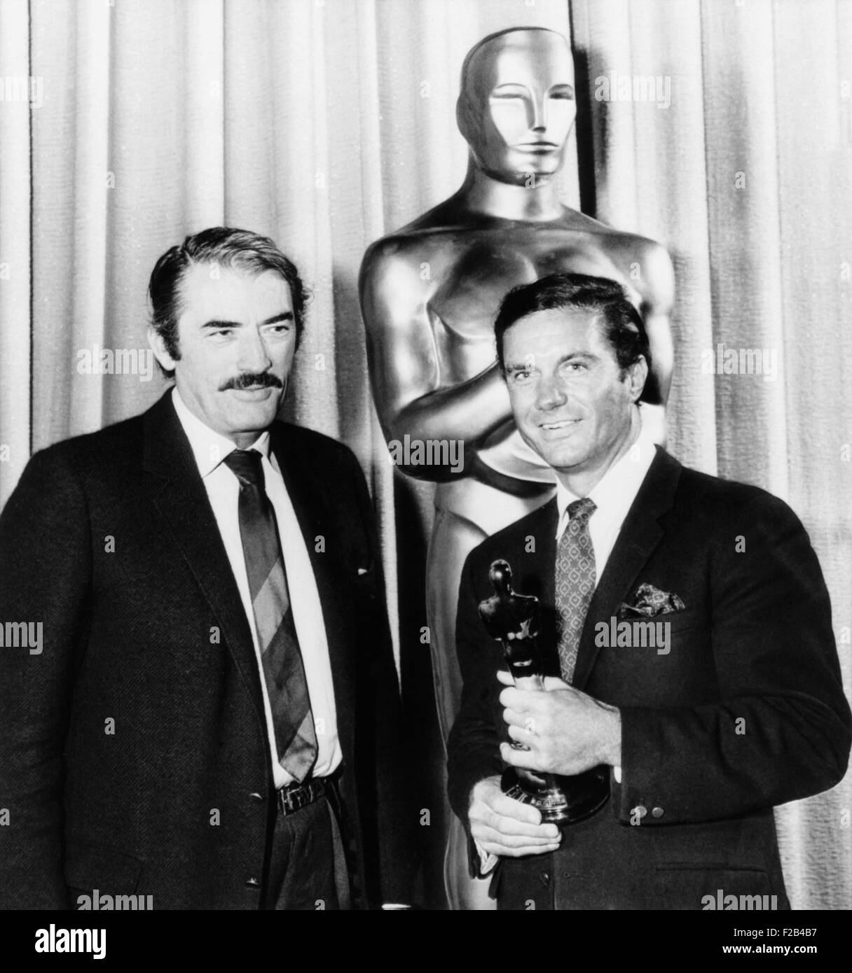 Cliff Robertson (right) receives a belated Best Actor 'Oscar' for his film 'Charley'. It as presented - Stock Image