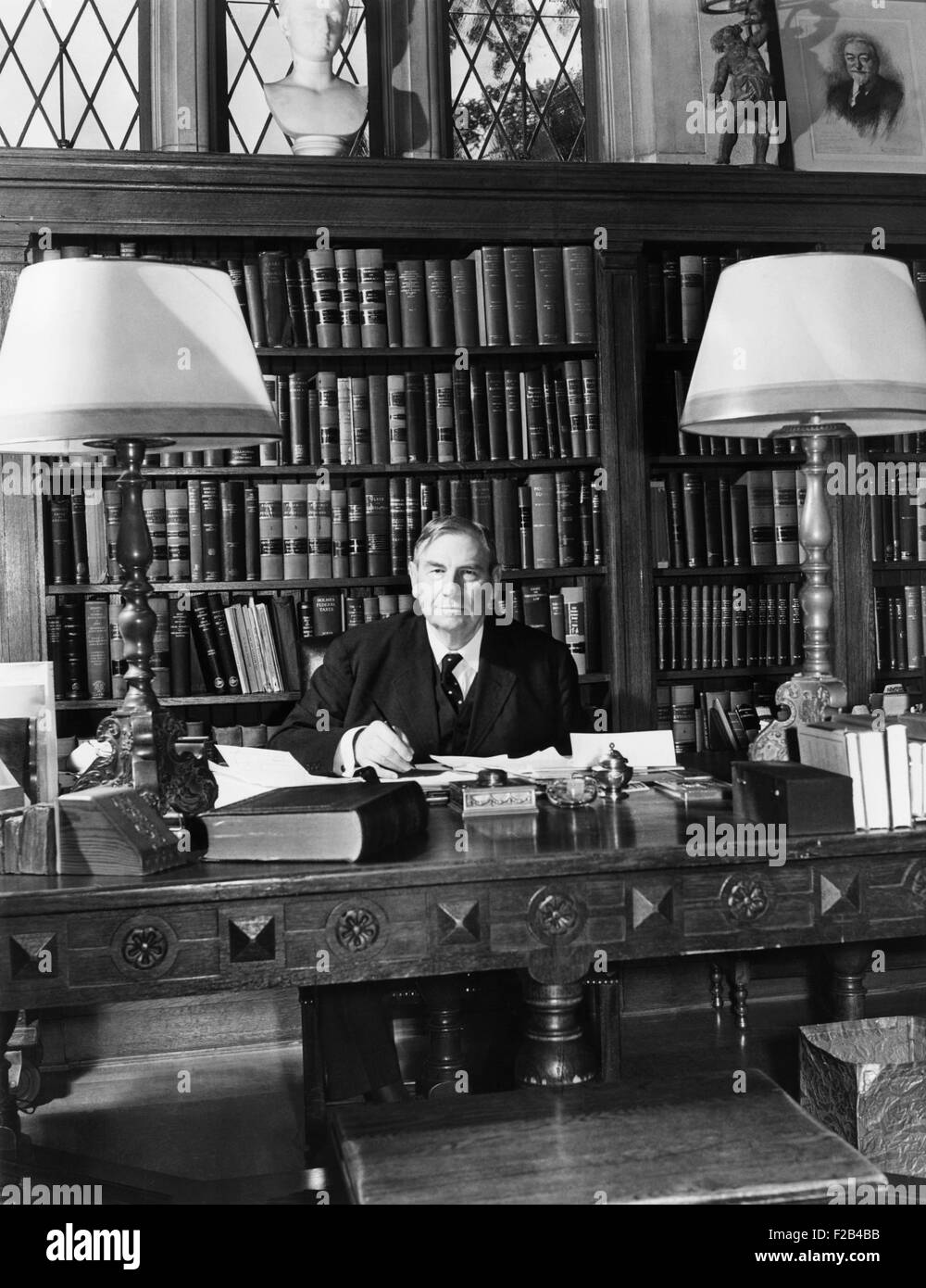 Chief Justice Harlan Fiske Stone of the U.S. Supreme Court at work in his study, Oct. 4, 1941. - (CSU_2015_5_119) - Stock Image