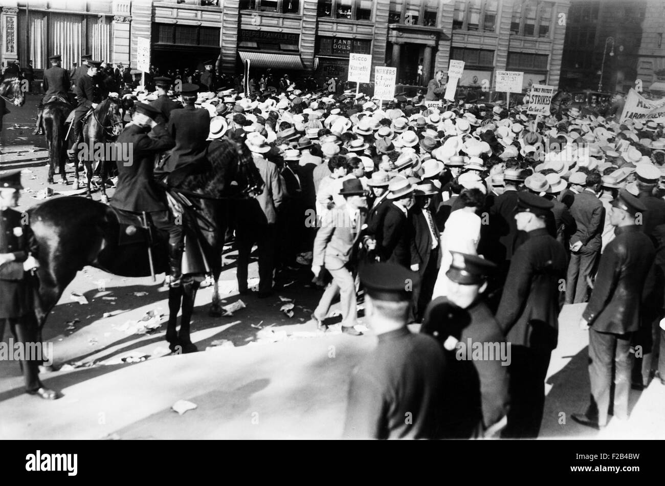 Mounted police forcing their horses to disperse the great horde of socialists at Union Square. They were attending - Stock Image