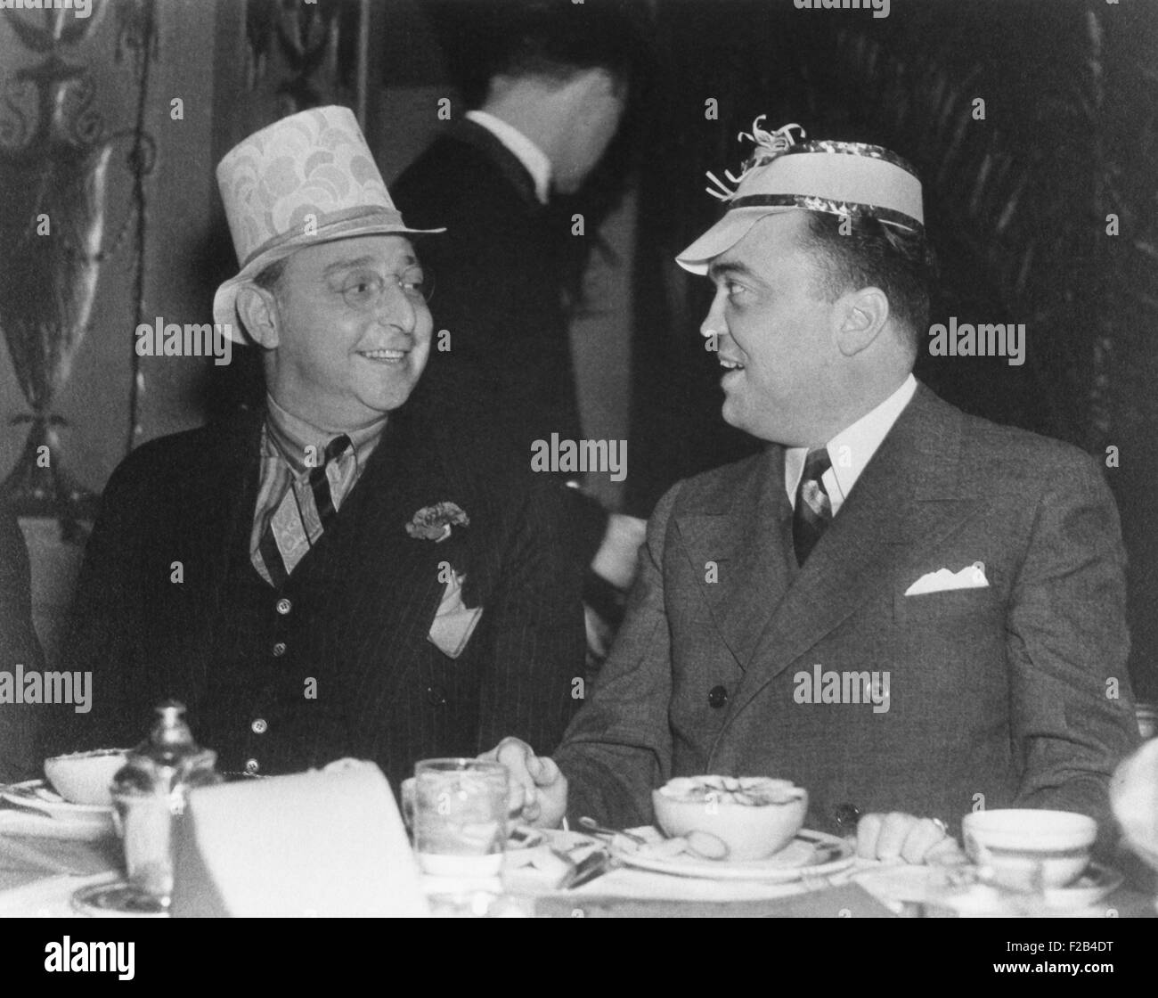J. Edgar Hoover and Julius Lulley enjoying a festive breakfast at Washington's Mayflower Hotel. Ca. 1935. Julius - Stock Image