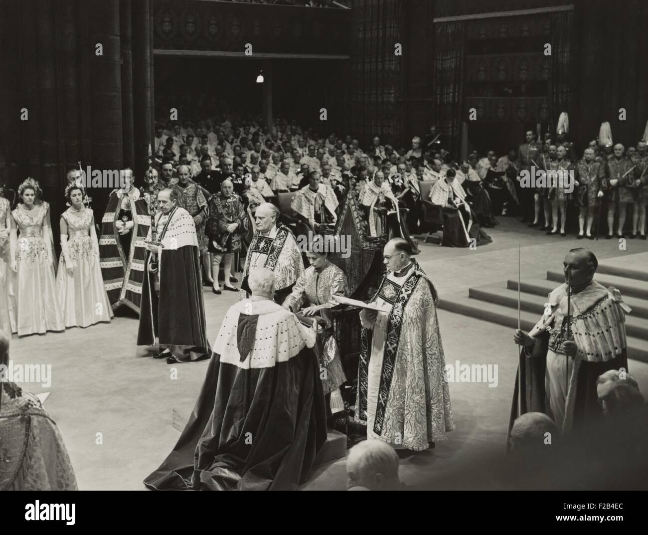 Coronation ceremony of Queen Elizabeth II, June 2, 1953. She is receiving the Spurs of Chivalry from the Lord Great - Stock Image
