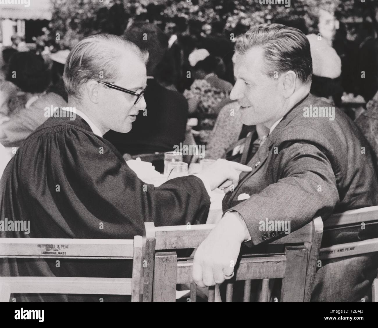 New York governor Nelson Rockefeller talking with his youngest son, Michael, at Harvard in June 1960. Michael disappeared - Stock Image