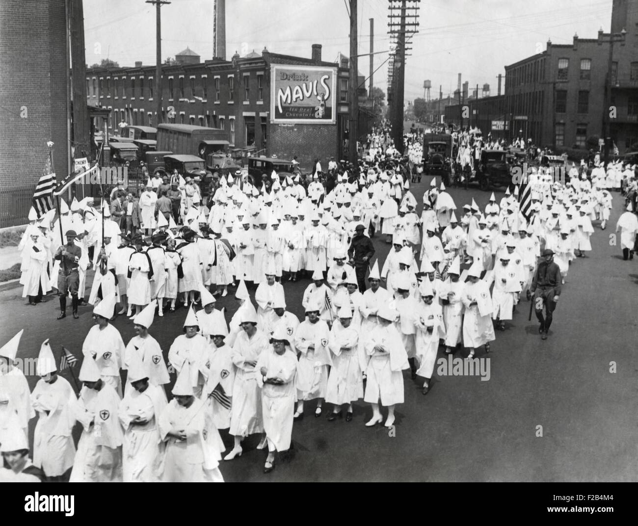 Ku Klux Klan parade in an unidentified American city. In the 1920s the Klan presented itself as a fraternal organization, - Stock Image