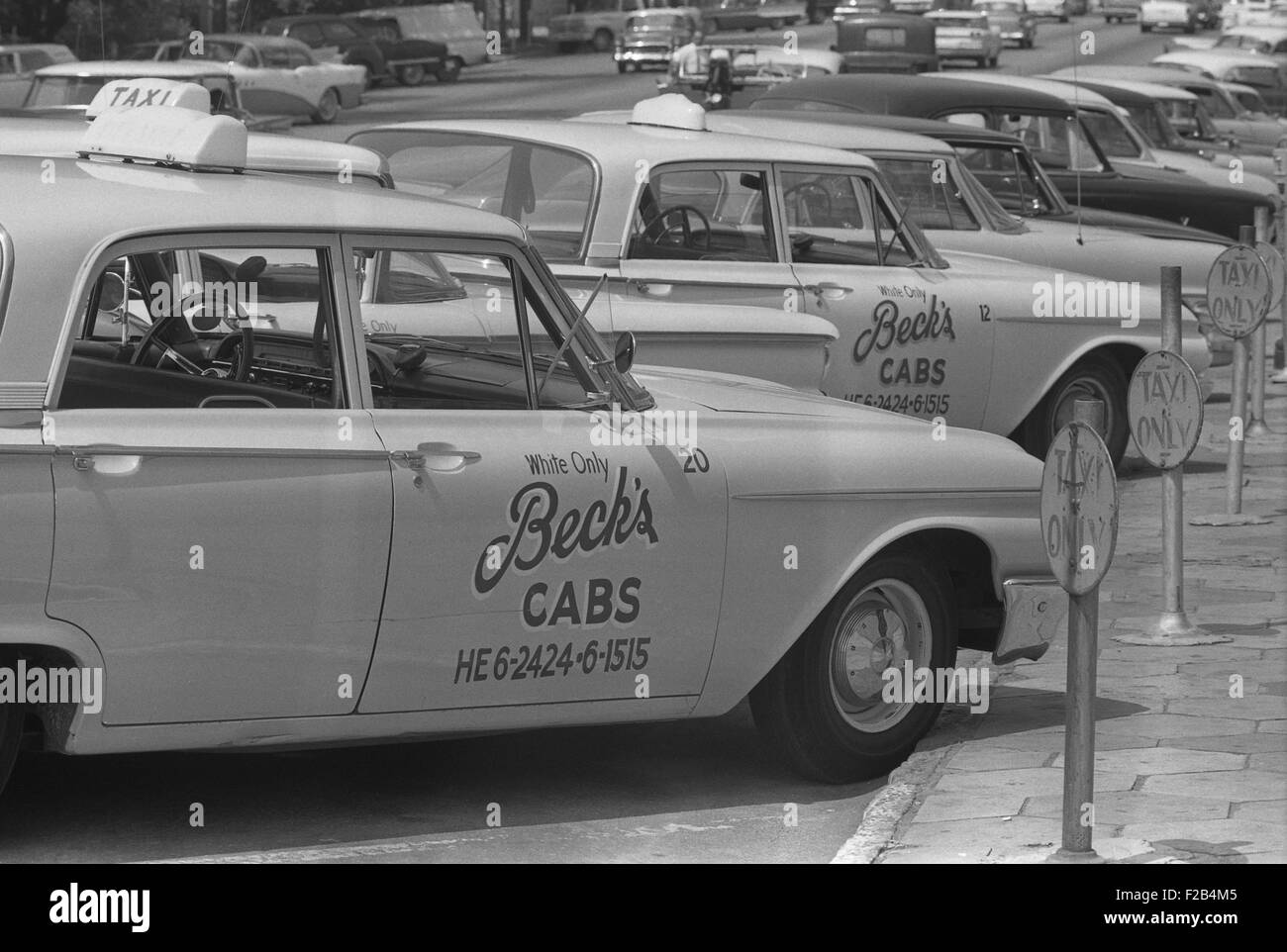 Segregated taxi cabs with sign 'White only, Becks cabs' on side door, Albany, Georgia. Aug. 18, 1962. - - Stock Image