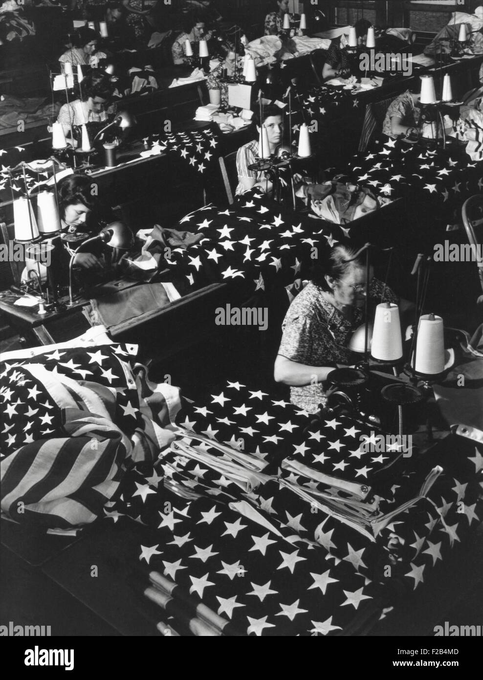 Women sewing American Flags in Brooklyn, New York City on July 24, 1940. Photo from the Records of Naval Districts - Stock Image