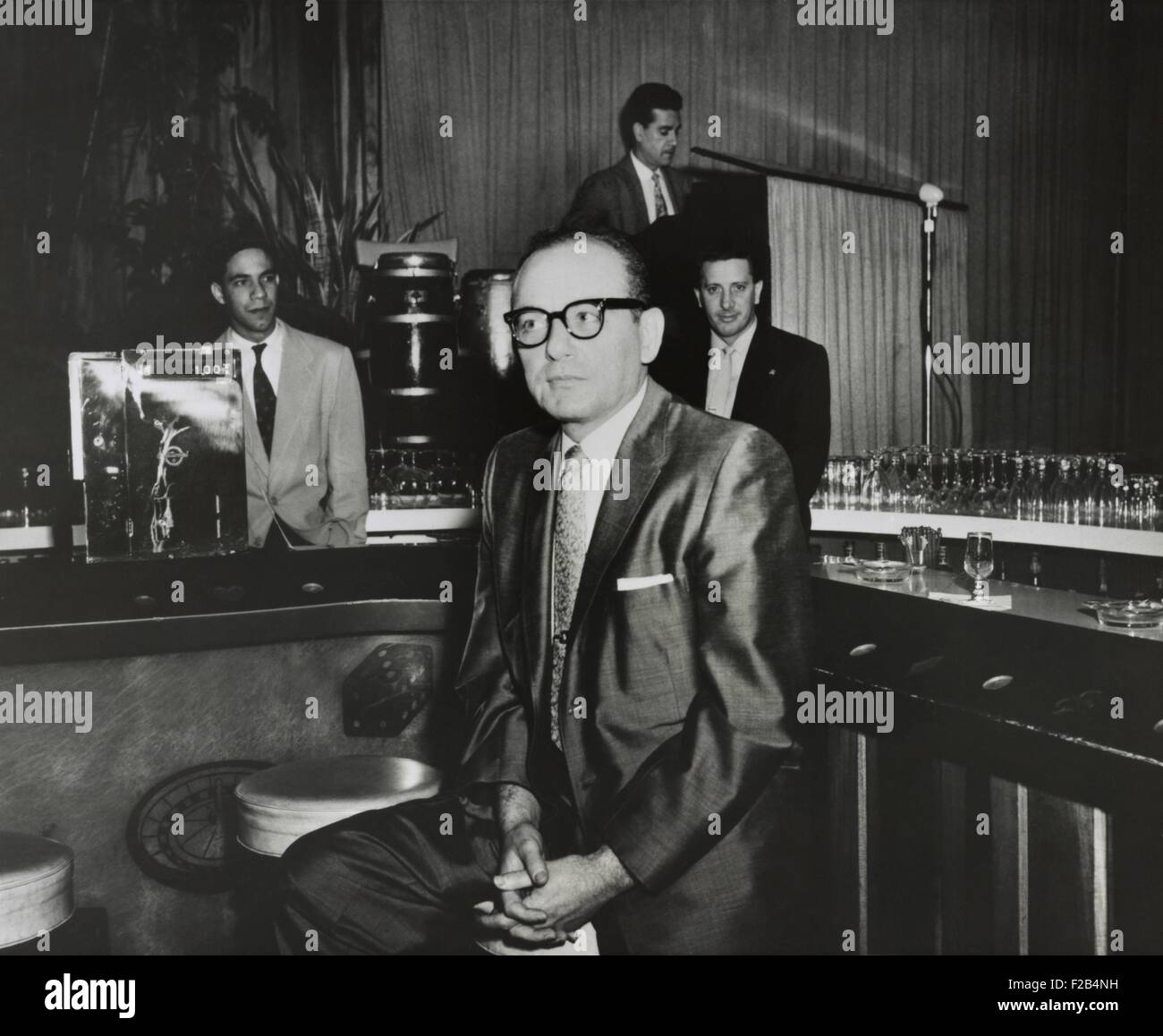 Gangster Santo Trafficante sitting on a stool in his Sans Souci Night Club in Havana, Cuba. Jan. 15, 1958. He was - Stock Image