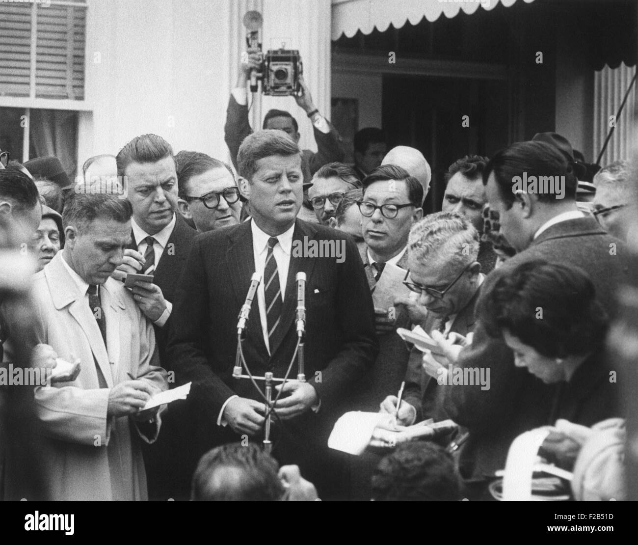 President-elect John Kennedy speaks to reporters outside the White House after his meeting with President Dwight - Stock Image