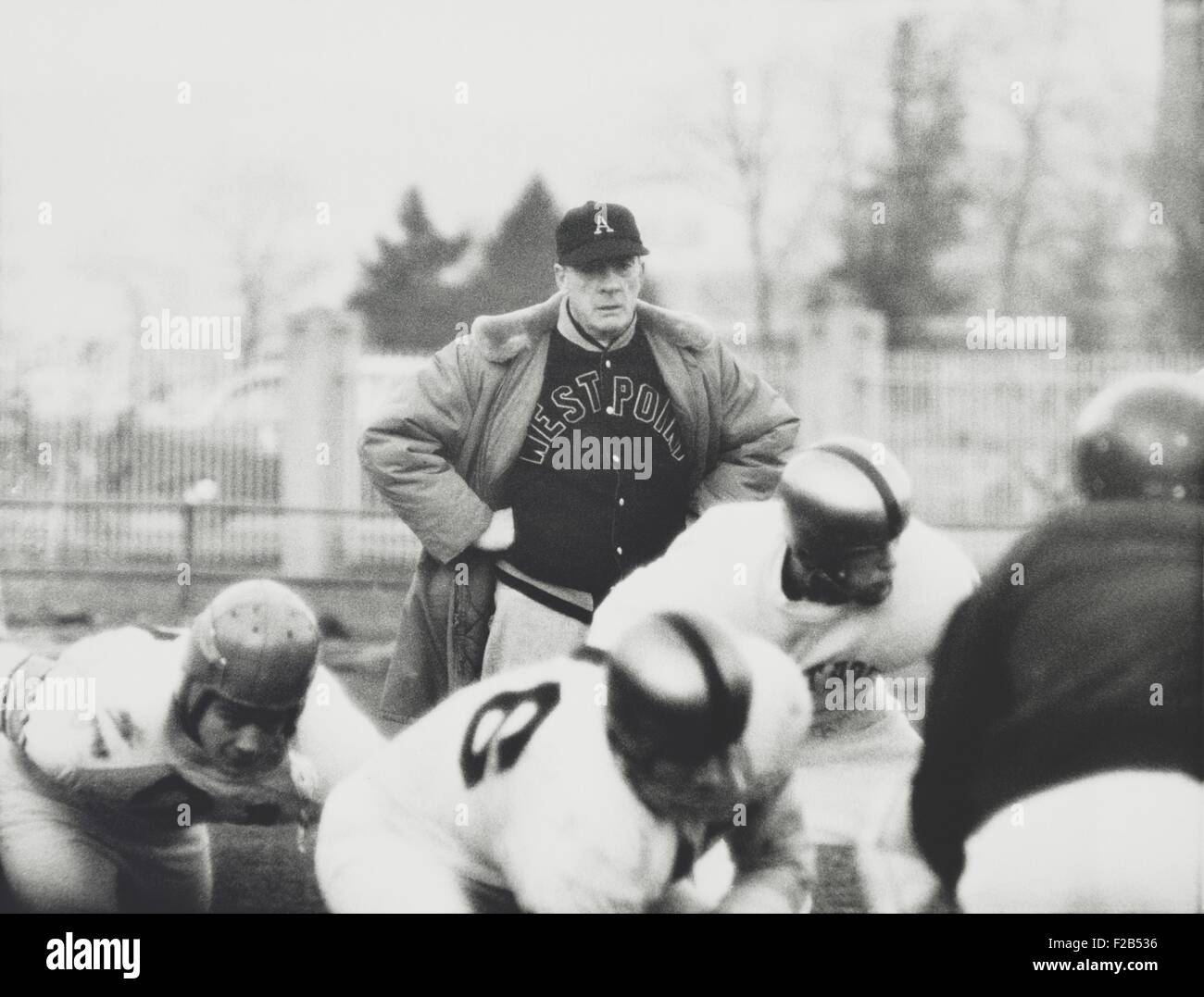 Football coach Earl 'Red' Blaik, oversees his players as they practice. Nov. 28, 1956. - (BSLOC_2015_1_111) - Stock Image